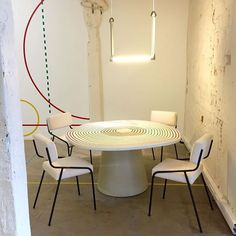table by Pierre Charpin, 1950s chairs, Trapeze light by Jaime Hayon, via Galerie Kreo