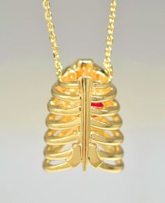 here is no better way to celebrate a milestone in your life then with a piece of jewelry. This customer wanted to celebrate the completion of her education with a special pendant representing her medical profession in the Xray field. She loved the rib cage so much we made two, one as a necklace and one to go on her charm bracelet. They were both made with 14k yellow gold, complete with a ruby heart.