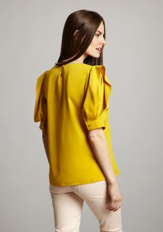 Split, puffed sleeve silk blouse.