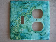 Individually hand-painted light switch.  Decorated using using vibrant alcohol inks on sea tones.