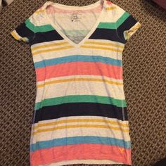American eagle stripe pocket tee Great condition. Minimal wear. No damage. Small pocket on the left side American Eagle Outfitters Tops Tees - Short Sleeve