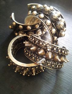 Miao studded and spiked cuffs