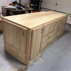 workbench with tools flipped into storage cabinets #WoodworkingTools
