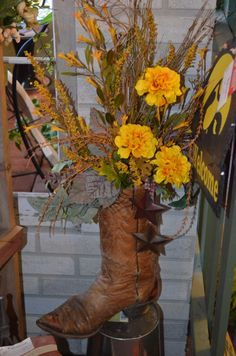 Custom Made Cowboy Boot Arrangement Sarah's Flowers & Gifts 102 Legion Street Manchester Iowa 52057  563.927.8247 www.sarahsflowersandgifts.com