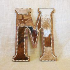 this stunning cowhide wall letter m is perfect for a western home or western nursery - Home Decor Wall Hangings