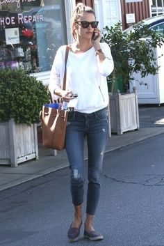 Alessandra Ambrosio wearing Mansur Gavriel Bucket Bag, Schultz Alpargata Ethnic Black Espadrilles and Mother the Looker Ankle Fray Jeans in Alley Cat
