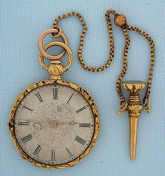 Lovely French 18K gold ladies antique pendant watch with matching key and short chain by Delamare Jne, Paris, circa 1830.