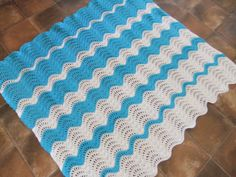Ripple Romance Afghan, free pattern by Michele Maks. A lighter, more open ripple for warmer weather. I like the stripe sequence of this one from the Ravelry Project Gallery. #crochet #blanket #throw