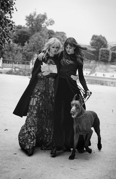 "Lara Stone reads to Freja Beha Erichsen in ""Novel Romance"" for W Magazine, November 2015. Photograph by Peter Lindbergh. A modern twist on the classic girl-meets-boy as the pair pose in the city of love, Paris, for the romantic images. ""Lanvin cape,..."