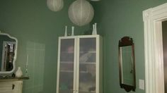 Guest room. Eyelet paper lanterns.  Vases from thrift stores