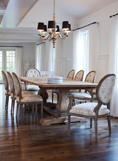 Sophisticated Dining Room with Reclaimed Wood Trestle Dining Table, surrounded by French Script Dining Chairs.