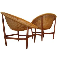Teak & Wicker Chairs by Nanna Ditzel. Original pair of classic easy chairs designed by Nanna Ditzel and manufactured by Ludwig Pontoppidan. This matched pair has remained together their entire lives and saw very little use to remain beautifully intact. Ca.1960