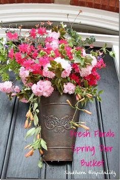 Gather flowers and greenery from your yard to create this gorgeous Spring Floral Arrangement for your door! Be sure to save to your DIY Board!