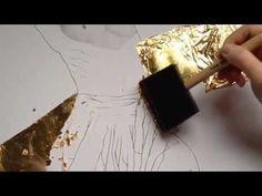 aplicando pan de oro en la pintura