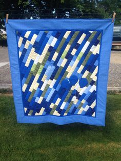 Baby boy quilt scrap strips balloon appliqués blues greens yellows