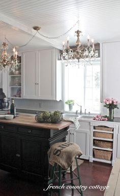 1940's Cottage Kitchen Before and After..... I like way she hung the two chandeliers from one electrical box.  Creative fix!