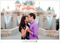 Engagement photo in front of Sleeping Beauty's castle at Disneyland