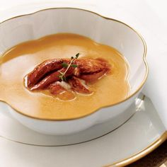 Pumpkin Soup with Creole Lobster | This delicious pumpkin soup is topped with lobster bathed in a spicy butter. The natural brininess of the lobster helps bring out all the deep, earthy flavor in the soup.