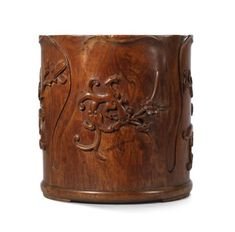 A VERY RARE AND FINELY CARVEDHUANGHUALI'CHILONG'FLORAL-FORM BRUSH POT LATE MING-EARLY QING DYNASTY;  sold. 687,500 HKD;   28/11/17.