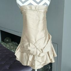 """Champagne formal dress NWOT Brand new no tags   Stunning and elegant Champagne colored strapless dress with ruffle details at the bottom. Edgy zipper details on some ruffles and bust area. Pair with sassy heels and statement jewerly    Size:  small Bust 32""""-34"""" around  length 26""""   *Special occassion, formal, Homecoming, prom, wedding, bridesmaid, gold*   Dresses Prom"""