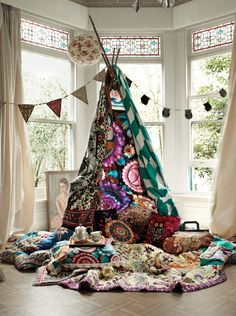 A colorful teepee is the perfect reading nook for the young and the young at heart. Pile on the quilts and throw pillows, set drinks a serving tray, and hide away for hours. Styled by Emma Persson Lagerberg and photo by Petra Bindel via petrabindel.com