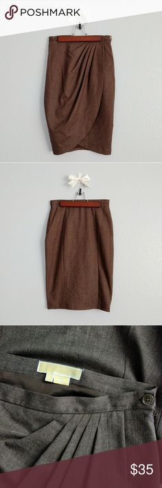 NWOT wool tulip skirt NWOT MICHAEL KORS wool tulip skirt. the color is an ashy brown melange, the close-up photos are most true to color. such a pretty drapey fit! this item has been tried on, but never worn.  measurements: waist to bottom length: 23.5 inches waist: 13 inches Michael Kors Skirts