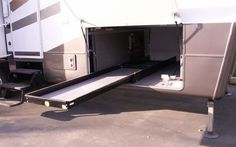 Another heavy duty slide out tray installed in 5th wheel main storage