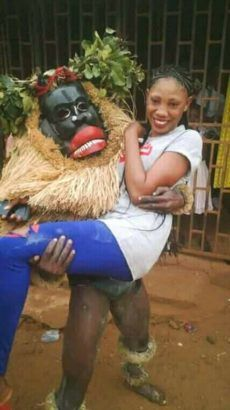 Mixed Reaction on Facebook as Masquerade Pictured Carrying a Beautiful Lady http://ift.tt/2CBUeww