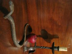 Antique Wrought Iron Snake.  Many of these Snakes were used as a symbol of protection in the Colonial Home.  Today most of these Antique Wrought Iron Snakes are found only in Virginia and North Carolina.  Sold North Bayshore Antiques