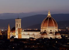Cattedrale di Santa Maria del Fiore. Brunelleschi's Dome, the nave, and Giotto's Campanile of the Florence Cathedral as seen from Michelangelo Hill at night and day.