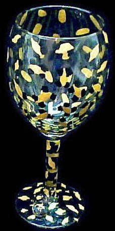 Gold Leopard Design Hand Painted Grande Wine Glass by Bellissimo. $34.95. Every product is thoroughly inspected to meet our strict quality control criteria, and then fired twice to insure durability.. For generations of pleasure and enjoyment, hand washing is recommended for all Bellissimo! merchandise.. Highly collectible, each piece of Bellissimo! is individually signed by the artist.. Bellissimo! is the manufacturer of America's Premier Hand Painted Glasswar...