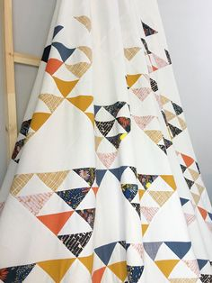 The Fly Away quilt design is a classic heirloom quilt pattern with a modern, asymmetrical twist. Use scraps or yardage, either way this is a fun pattern!