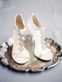 wedding shoes with silver hearts | photo by Taylor Lord http://ruffledblog.com/spring-wedding-with-an-illusion-lace-gown
