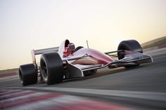 You can almost smell the asphalt as this racing car speeds past in a motion blur. Soft reds, greys and creams make our Racing Car Wallpaper Mural a soft but striking winner in every sense. Stage Pilotage, Race Car Bedroom, Spanish Grand Prix, Course Automobile, Car Racer, Uk Holidays, Motion Blur, Checkered Flag, Stop Light