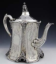 English silver tea pot with Chinese figural finial