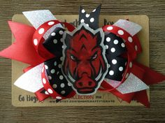New! Made especially for those sweet Hog fans out there.  This bow measures about 3.5x6 and the hog topper measures about 3x1.5. It is on a regular-sized alligator hair clip.  Makes a perfect gift as well!  Go Hogs!  -Tomomi