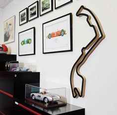Nice idea for the circuit outline. I can imagine it would look good with a single model car mounted vertically on the wall alongside.