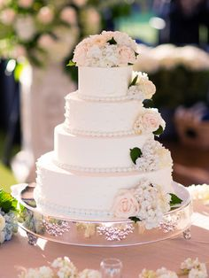 Four-Tier Flower-Decorated Wedding Cake | Jonathan Young Weddings https://www.theknot.com/marketplace/jonathan-young-weddings-brooklyn-ny-239407 |
