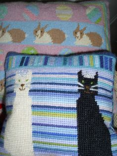 Just a couple of needlepoint cats - wearing crowns.  Well, they all think they're royalty anyway, don't they?    http://rubykittyruby.weebly.com/blog