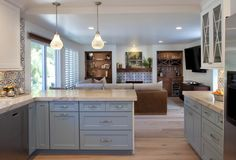 Colorful Kitchen design with blues, grays and white featuring Dura Supreme Cabinetry. Built in entertainment wall highlights the blue and white fireplace design. Kitchen On A Budget, Kitchen Redo, New Kitchen, Kitchen Remodel, Kitchen Ideas, Kitchen Cabinets, Kitchen Worktop, Kitchen Counters, Design Kitchen