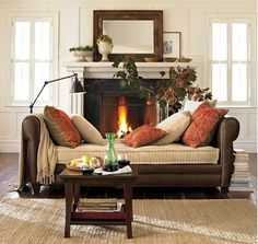 Comfy pillows and throws warm up this cozy spot - Autumn-inspired Interior Design