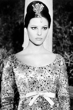 Claudia Cardinale in The Pink Panther, 1964 I Photo Alamy I Claudia's wardrobe for the film was designed by Yves Saint Laurent Claudia Cardinale, Blake Edwards, Rosa Panther, Sicilian Women, Divas, Panthères Roses, Der Leopard, Yves Saint Laurent, Italian Actress