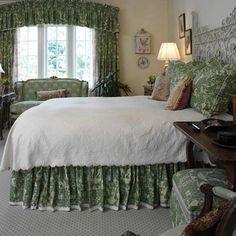 Green, gardenisk with antique fencing headboard