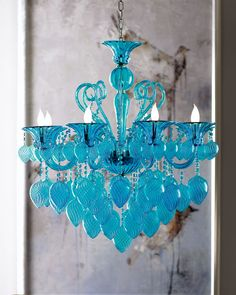 "Today's rooms need color, and this provides plenty of it in got-to-have-it style. Made of blown glass with an applied aqua color, this chandelier uses eight 60-watt bulbs. 34""Dia. x 36""T with 8'L chain. Ceiling canopy included. Imported."