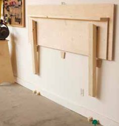 Folding Work Bench Woodworking Plan, Shop Project Plan | WOOD Store  *I think I want to re-make this idea so it comes up from the floor or at least lower on the wall.