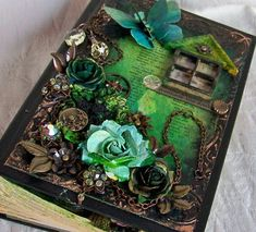 altered book cover... hmmm, combined with the hollowed out book idea??? would make a pretty and unique treasure box :)