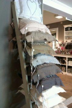 Cushion display on ladder