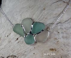 Sea glass jewelry. I love using recycled stuff like this, it kind of has it's own story. Beautiful piece.
