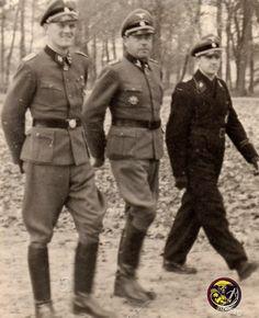"SS-Sturmbannführer Heinrich ""Hein"" Springer (Divisionsadjutant 12. SS-Panzer-Division ""Hitlerjugend""); SS-Oberführer Fritz Witt (Kommandeur 12. SS-Panzer-Division ""Hitlerjugend""); dan SS-Hauptsturmführer Georg Isecke (Adjutant SS-Panzer-Regiment 12 / SS-Panzer-Division ""Hitlerjugend"")"