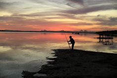 A Wilder Light. Pumicestone Passage, Bribie Island, Sunset over the Glasshouse Mountains. Fishing.